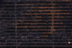 Rusty metal grill plate Stock Image