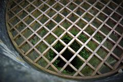Wrought-iron grille deep well stock photography