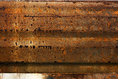 Rusty metal guardrail background. Old rusty vintage spotted metal guardrail background Royalty Free Stock Photos