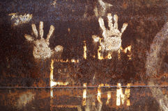 Rusty metal with handprint Royalty Free Stock Photography
