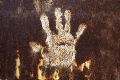 Rusty metal with handprint Royalty Free Stock Image