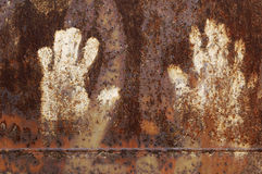 Rusty metal with handprint Royalty Free Stock Photo