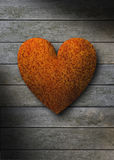Rusty metal heart against gray weathered wood Stock Image