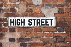 Rusty Metal High Street Road Sign On Brick Wall