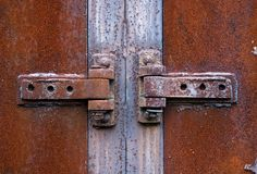 Rusty metal hinge Stock Images