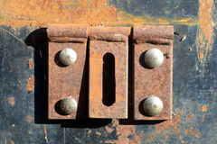 Rusty metal hinges. On box Royalty Free Stock Image