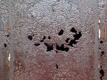 Rusty metal and holes Royalty Free Stock Photo