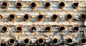 Rusty metal air conditioner coils in a junkyard. Rusty metal industrial air conditioner coils found in a salvage yard inspire a repeating industrial background stock image