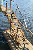 Rusty metal ladder #2. Rusty metal ladder of pontoon bridge over water Royalty Free Stock Image