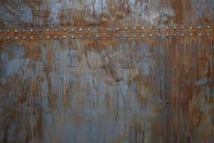Rusty Metal med nitar Royaltyfri Fotografi