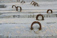 Rusty metal mesh on concrete close up stock image