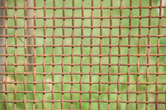 Rusty metal mesh. Detail of a rusty fence of metal mesh Stock Photo