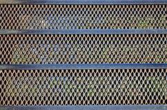 Rusty metal mesh texture Stock Images