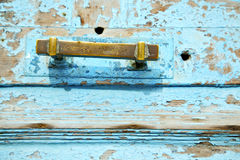 Rusty metal nail dirty stripped paint in the blue Royalty Free Stock Image