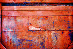Rusty metal with old cracked paint. Natural rusty metal with old cracked paint of different colors and shades Stock Images