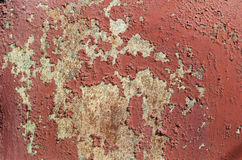 Rusty metal and old paint. Rusty metal covered with an old cracked paint royalty free stock photo