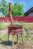 Rusty metal oven and grill in backyard in a sunny summer day Stock Photography
