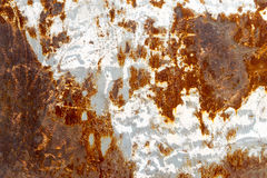 Rusty metal panel beside the car Stock Photography