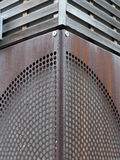 Rusty metal patterned cladding joined on a corner Stock Photography