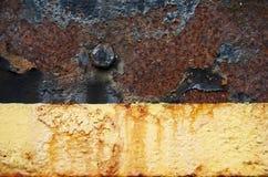 Rusty metal peeling paint background Stock Photos