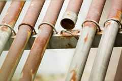 Rusty metal pipe for electric cable. stock image