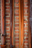 Rusty metal pipe on red brick wall. Whethered rusty metal pipe on red brick wall Royalty Free Stock Images