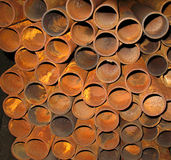 Rusty metal pipes. Stock of rusty metal pipes in engineering shop Stock Images