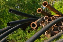 Rusty metal pipes in the forest Royalty Free Stock Photos
