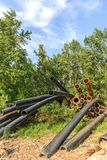 Rusty metal pipes in the forest Stock Photo