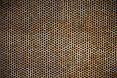 Rusty metal plate holes Stock Images
