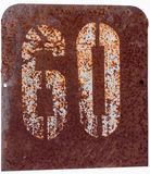 Rusty metal plate with the number sixty. Isolated Royalty Free Stock Image