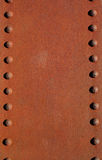 Rusty metal plate with rivets Stock Photography