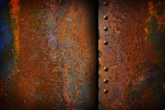 Rusty metal plate with a seam. And rivets Royalty Free Stock Images