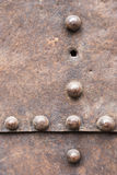 Rusty metal plate with a seam and rivets Stock Images