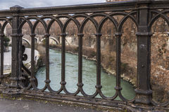 Rusty metal railing of a bridge in Rome, Italy Stock Image