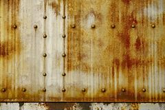 Rusty Metal with Rivets. Photo Background. Nasty Backgrounds Collection royalty free stock photo