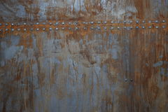 Rusty metal with rivets. Texture of rusty metal with rivets royalty free stock photography