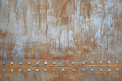 Rusty metal with rivets. Texture of rusty metal with rivets Stock Photography