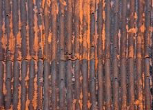Rusty Metal Roof. Rusty corrugated iron roof background texture stock images