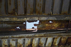 Rusty metal roof with big hole in it Stock Photos