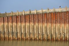 Sea wall. Rusty metal sea wall in Seaford, East Sussex Royalty Free Stock Photography