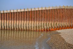 Sea wall. Rusty metal sea wall in Seaford, East Sussex Royalty Free Stock Photo