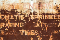 Rusty Metal Sign Background. A very rust metal sign with words and cracked paint Stock Image