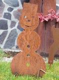Rusty metal snowmann shape in the garden royalty free stock photo