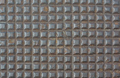 Rusty metal square pattern texture brown background Stock Image
