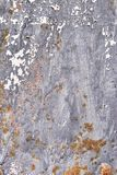 Rusty metal surface with dark blue paint flaking and cracking texture royalty free stock images