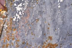 Rusty metal surface with dark blue paint flaking and cracking texture stock images
