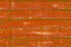 Rusty metal surface with grooves. A rusty weathered metal surface showing radiant colors Stock Photo