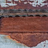 Rusty metal surface with nailed rubber tape royalty free stock images