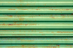 Rusty metal surface painted in green Stock Photos